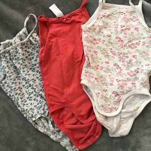 Set of three onesies, H & M